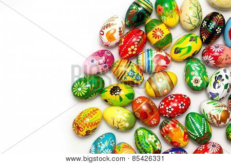 Hand painted Easter eggs isolated on white. Floral, colorful spring patterns and designs. Traditional, artistic and unique.
