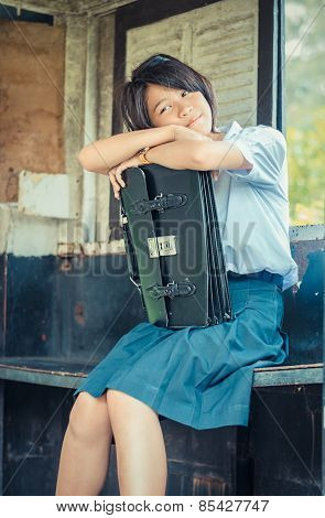 Cute Thai Schoolgirl Is Daydreaming In An Old Bus Stop