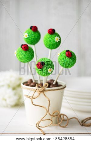 Cake pops decorated with fondant ladybugs