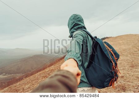 Traveler Woman Follows A Man On Nature