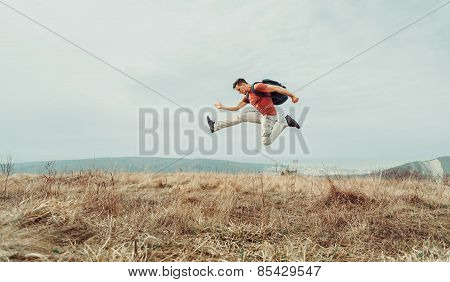 Traveler Man Jumping On Nature