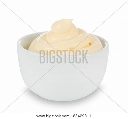 Mayonnaise in bowl on white table.