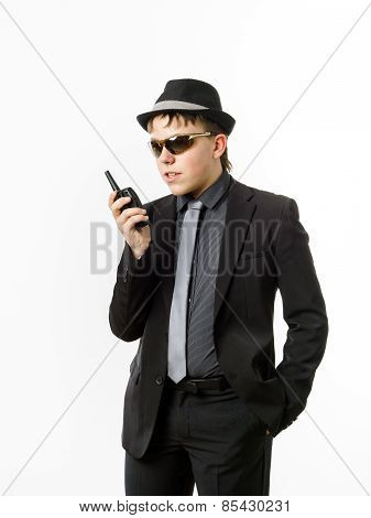 Teenage Boy Posing Like A Guardsman With Radio Transmitter