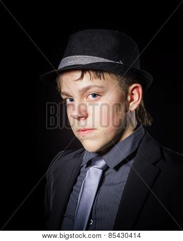 Teenage boy dressed in strong suit portrait