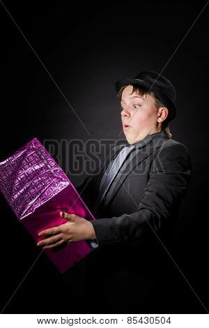 Expressive Teenage Boy Holding Box With Gift