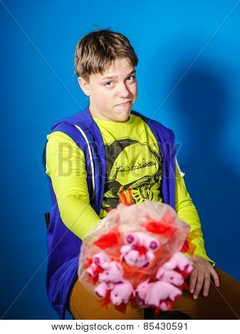 Teenage Boy Posing With Bouquet Of Flowers