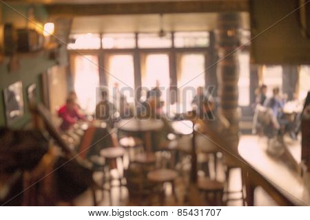 People in Coffee shop blur background with bokeh lights, vintage filter for old effect, blurred back