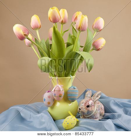 Easter themed concept with tulips and Easter Eggs