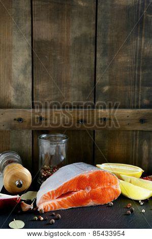 Salmon Steak On Wooden Background