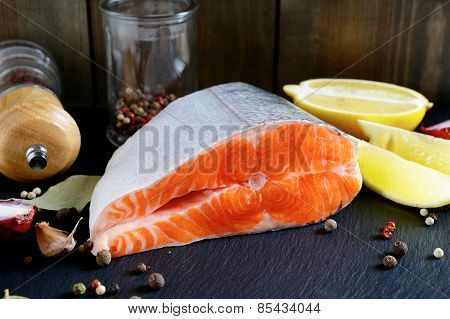 Raw Fresh Salmon Steak With Spices And Lemon