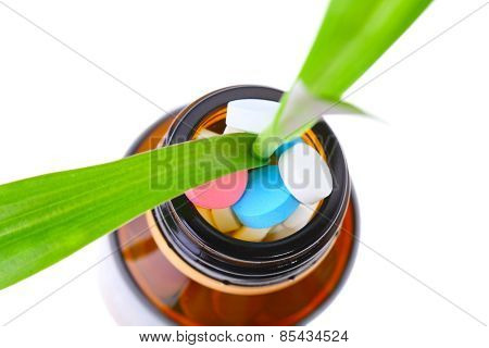 Green Plant In Bottle With Pills