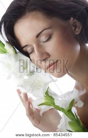 beautiful fresh face with gladiolus flowers