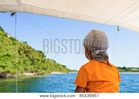 Child floats on a catamaran on the picturesque Lake
