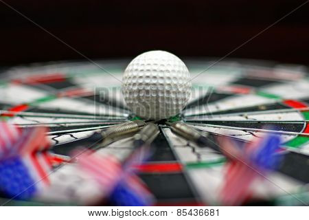darts and small ball in center of shield
