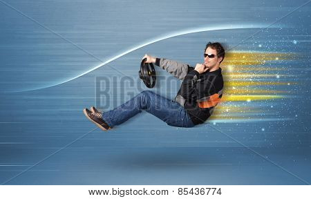 Young man driving in imaginary fast car with blurred lines concept