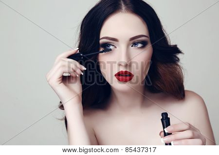 beautiful  Woman With Dark Hair And Bright Makeup With Mascara