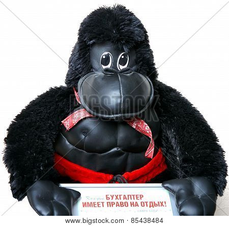 Accountant Has The Right To Rest.toy Monkey With A Sign In His Hand.the Big Black Monkey.