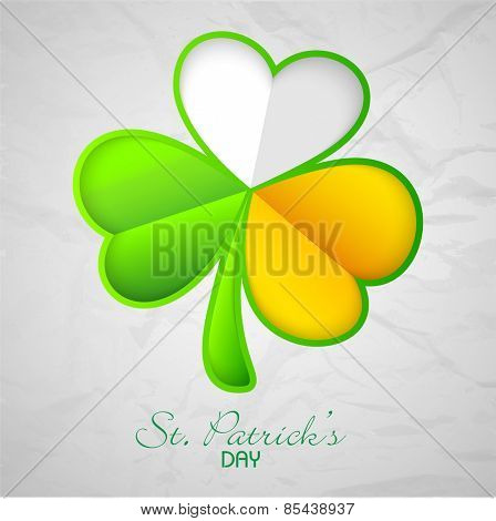 Glossy clover leaf in Irish Flag colors on grungy background for Happy St. Patrick's Day celebration.