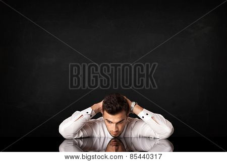 Depressed businessman sitting at a desk