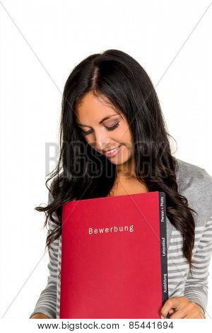 a young woman holding a folder for the application to an open job in hand.