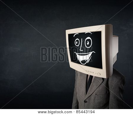 Happy businessman with a personal computer monitor head and a smiley face