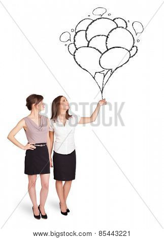 Happy young women dolding balloons drawing