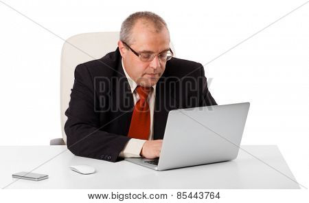 buisnessman sitting at desk and looking laptop with copy space, isolated on white