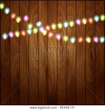 Christmas background with Christmas lights  wood texture.