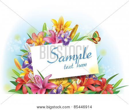 Arrangement of flowers with empty greeting card for text