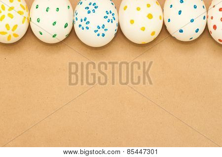 six spotted easter eggs on kraft background