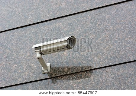 Security Camera On The Wall.