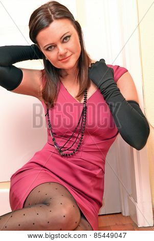 Caucasian fashion woman posing wearing pink dress.