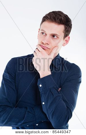 Portrait of worried young businessman