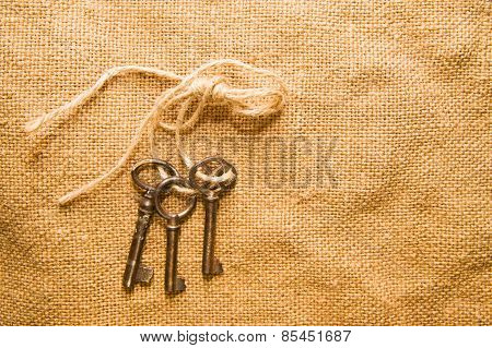 Three Old Keys Tied With A Rope On The Old Cloth
