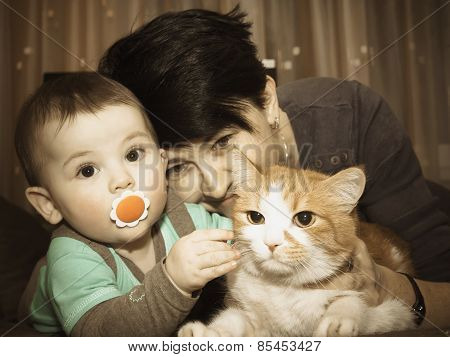 Caucasian Family Mother And Baby Playing With Cat