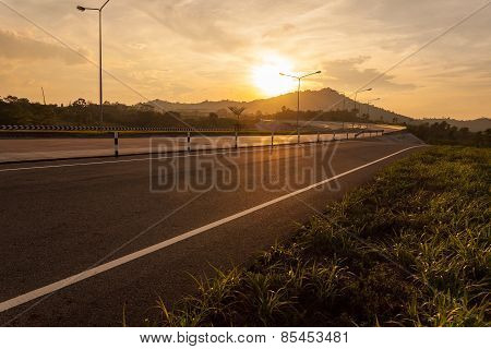 Road And Bridge During Sunset