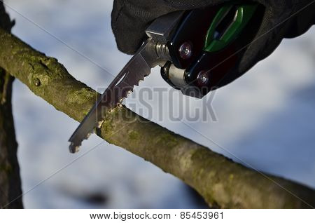 Survival Knife In The Winter Scenery