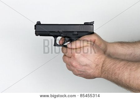 Shooter Holds Black Handgun