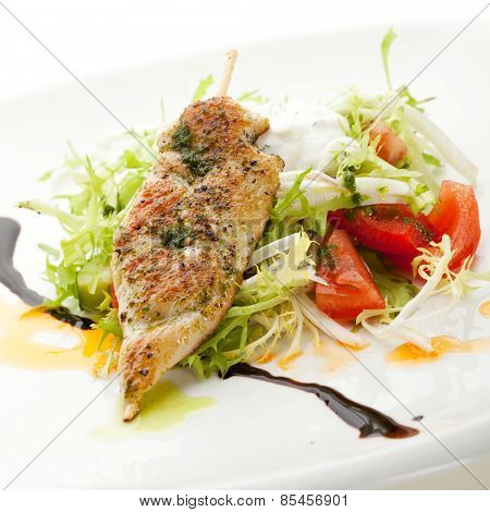Chicken Kebab on Fresh Vegetables Salad with Homemade Sour Cream
