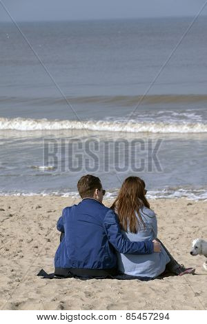 Young Couple In Love At The Beach, Enjoying The Sun