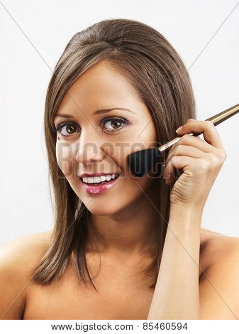 Young Woman Applying Make Up