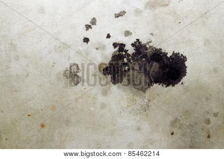 Closeup of stains on concrete floor