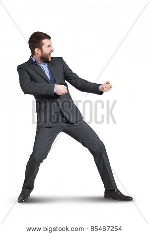 screaming businessman pulling invisible rope. isolated on white background