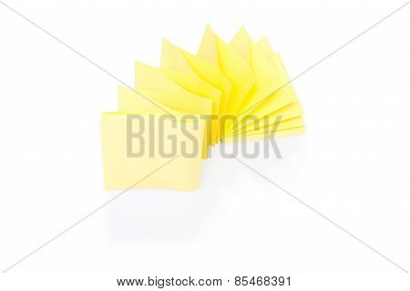 Blank yellow sticky note on block