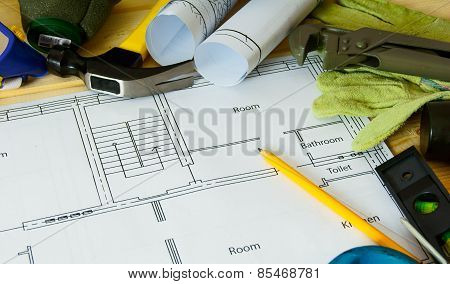 House construction. Drawings for building and many others tools on wooden background.