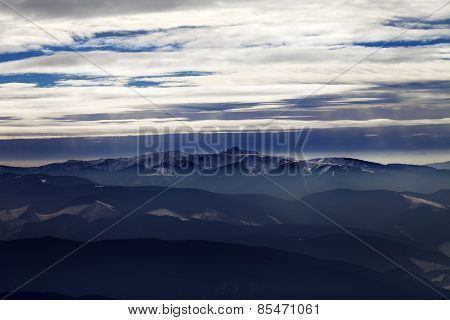 Silhouettes Of Cloudy Mountains In Evening