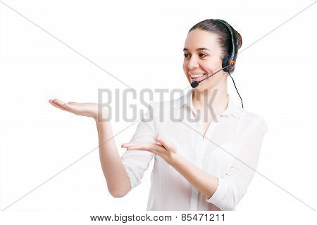 Portrait Of Happy Smiling Cheerful Young Support Phone Operator In Headset Showing Copyspace Area Or