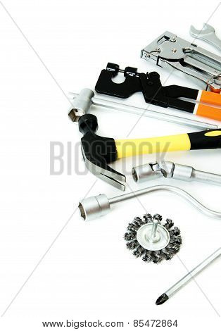 Metalwork. Hammer, stapler and others tools on white background.