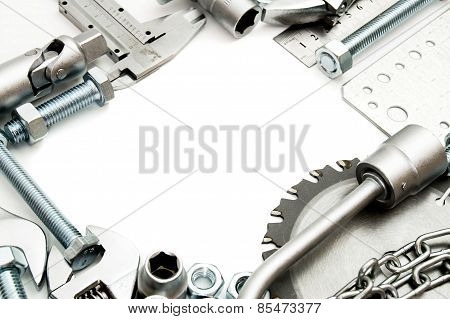 Metalwork. Ruler, wrench, screw and others tools on white background.