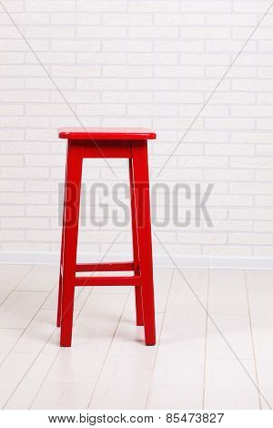Red Chair On A Brick Wall Background